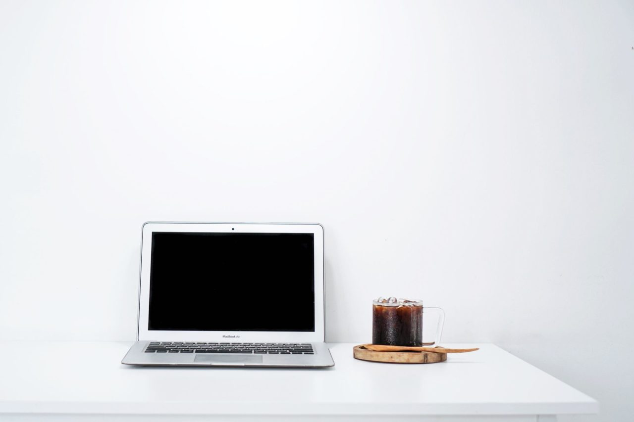 a laptop and an iced drink