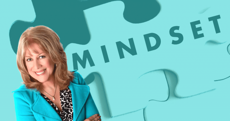debbie sardone in front of a mindset jigsaw puzzle background