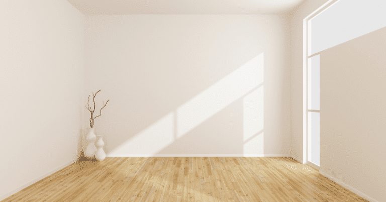 empty white room with wooden floors