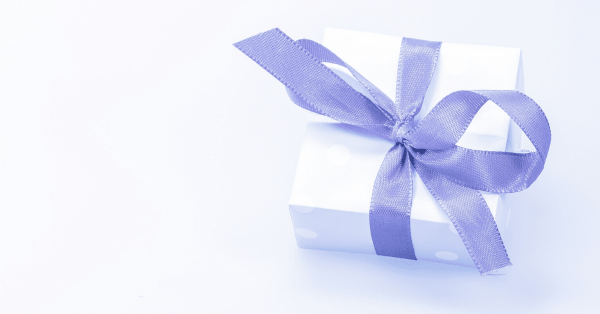 gift neatly tied using a purple ribbon