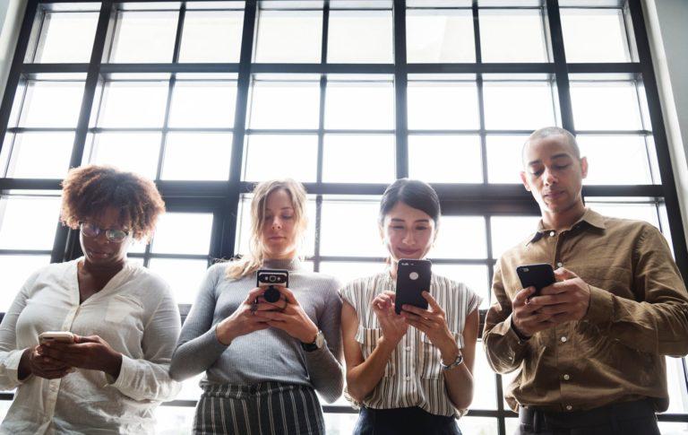 group of people lookting at their phones