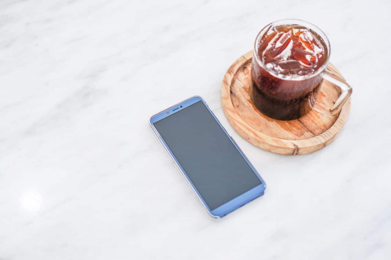 phone and coffee on the table