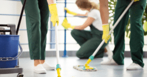 three people mopping an area