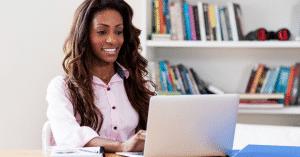 female in office on laptop ZenMaid Magazine