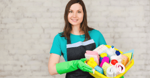 female cleaner with cleaning caddie