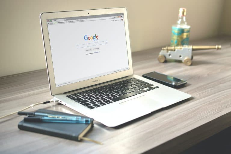 Laptop on desk with Google search