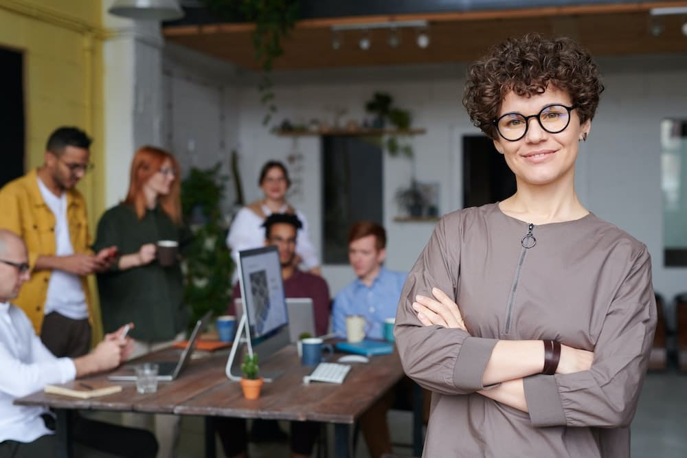 Female business owner with staff