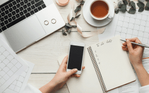 desktop with laptop and mobile phone to do list